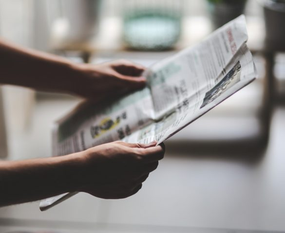 Man reading article in newspaper